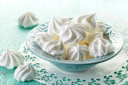 white eggs: meringue cookies in blue bowl