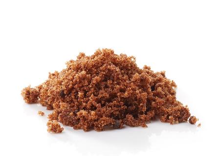sugar candy: brown muscovado sugar on a white background