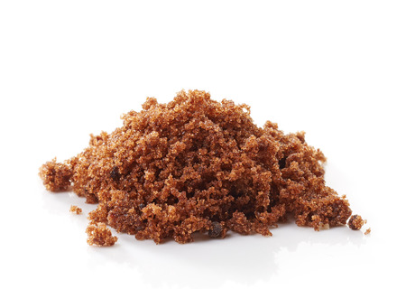 brown muscovado sugar on a white background