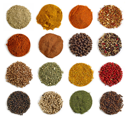 curry spices: various kinds of spices on a white background