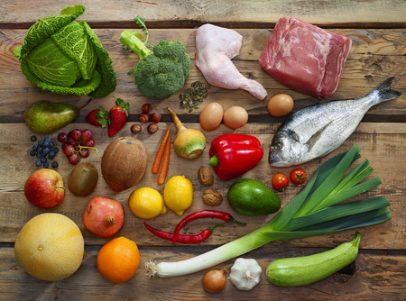 fish meat: Various Paleo diet products on wooden table, top view