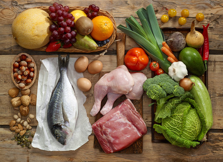 fish: Various Paleo diet products on wooden table, top view