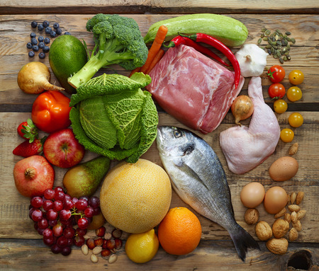 wooden table top view: Various Paleo diet products on wooden table, top view