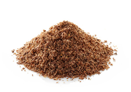 flax seeds: heap of crushed flax seeds isolated on white background