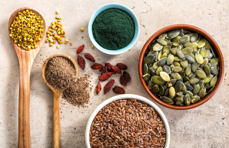 superfood: various kinds of superfood on kitchen table for healthy breakfast, top view Stock Photo