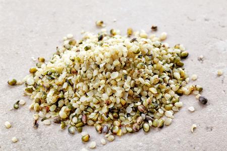 hemp hemp seed: heap of hemp seeds on kitchen table