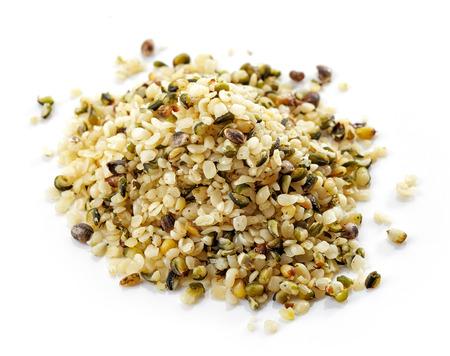 hemp: heap of hemp seeds isolated on white