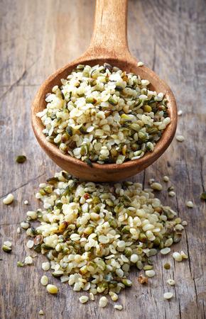 hemp hemp seed: spoon of hemp seeds on old wooden table background