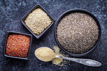 protein crops: various healthy seeds collection on dark background, top view Stock Photo