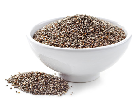 crunchy: bowl of healthy chia seeds isolated on white Stock Photo