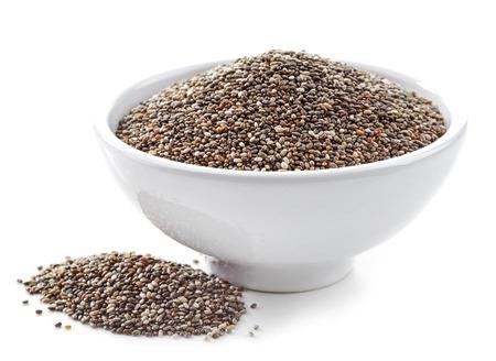 semilla: tazón de semillas de chía saludables aislado en blanco Foto de archivo