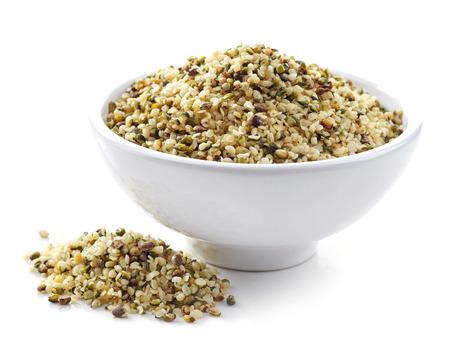 hemp hemp seed: bowl of healthy hemp seeds isolated on white Stock Photo