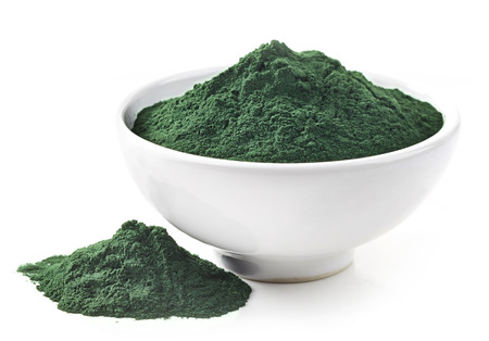 plant antioxidants: bowl of spirulina algae powder isolated on white