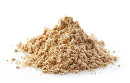 aphrodisiac: heap of maca powder isolated on white Stock Photo