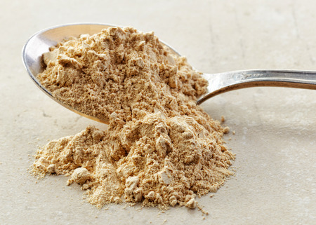 maca root: spoon of healthy maca powder Stock Photo
