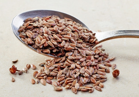 flax seeds: flax seeds in a silver spoon