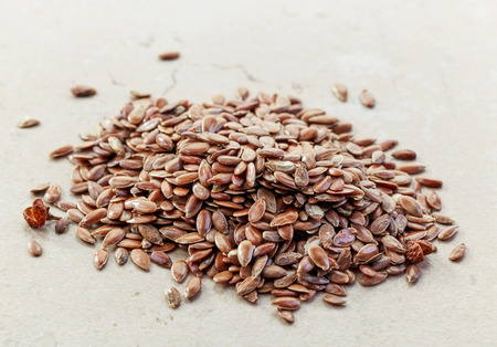 flax seeds: heap of healthy flax seeds Stock Photo