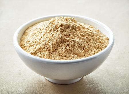 maca: bowl of healthy maca powder