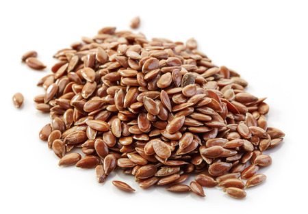flax seeds: heap of flax seeds isolated on white background Stock Photo
