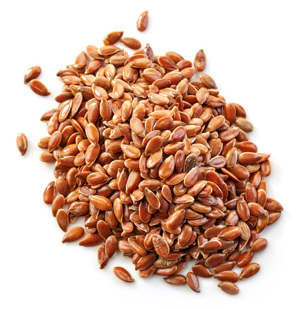 flax: heap of flax seeds isolated on white background Stock Photo