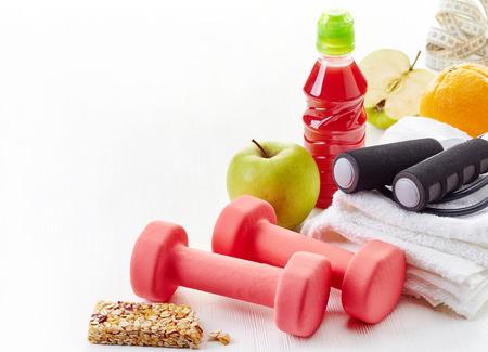 granola bar: Fitness equipment dumbbells on white wooden table