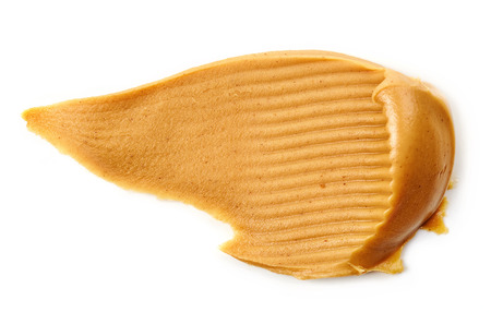 brown white: peanut butter spread isolated on white background