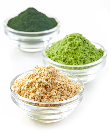 super macro: three bowls of various superfood powders isolated on white Stock Photo