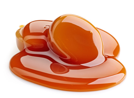 caramel sauce: caramel candies and sweet sauce isolated on white background