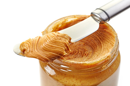 peanut butter: jar of peanut butter on a white background