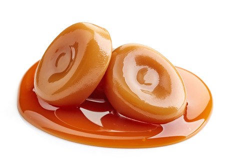 toffee: caramel candies and sweet sauce isolated on white background