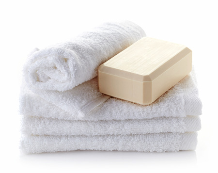 towel  spa  bathroom: stack of white spa towels and soap bar