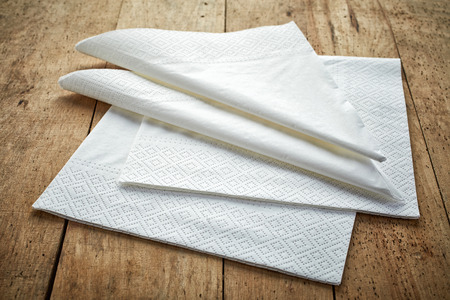white paper napkins on wooden table