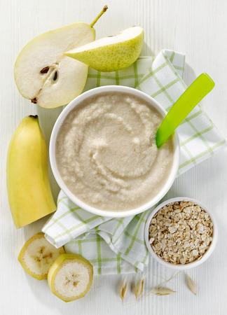 bowl of baby food, healthy breakfast porridge, top view
