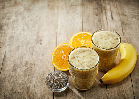 chia seed: Healthy banana and orange juice smoothie with chia seeds Stock Photo