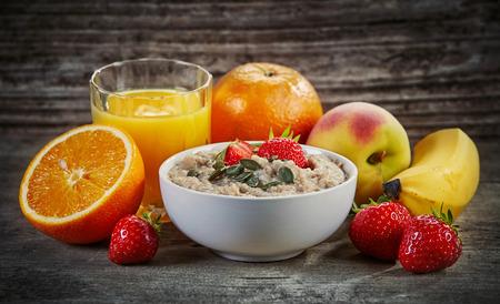 healthy breakfast: Healthy breakfast ingredients on dark wooden table Stock Photo
