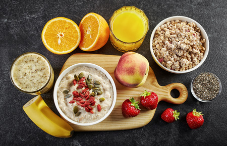 healthy breakfast: healthy breakfast ingredients on dark background