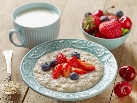breakfast bowl: oats porridge with fresh berries for healthy breakfast