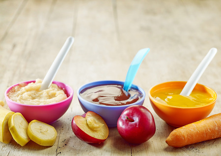 various: various kinds of baby food in plastic bowls
