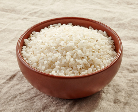 white rice: bowl of raw round white rice Stock Photo