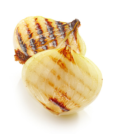 sweet and savoury: grilled onion pieces isolated on white background
