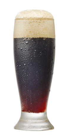 single beer: glass of dark beer isolated on white background