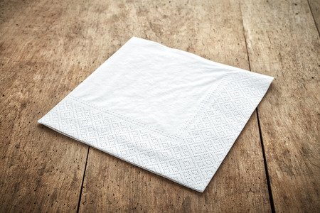 paper: white paper napkin on old wooden table Stock Photo