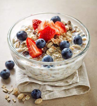 healthy breakfast: healthy breakfast, bowl of muesli with milk and fresh berries