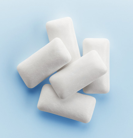 studio background: chewing gum on blue background, top view