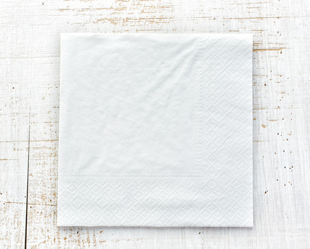 white paper napkin on wooden table