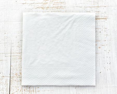 white paper napkin on wooden table