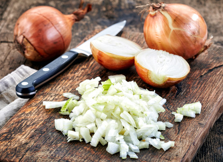 chopped onions on wooden cutting board Reklamní fotografie - 42628236