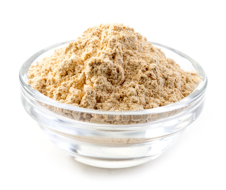 dried herbs: bowl of maca powder isolated on white background Stock Photo