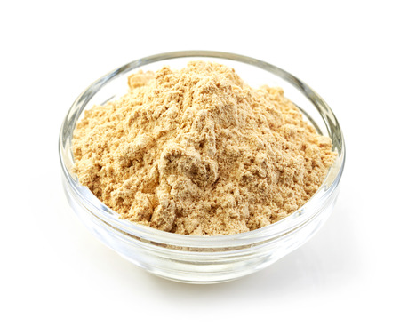 maca root: bowl of maca powder isolated on white background Stock Photo