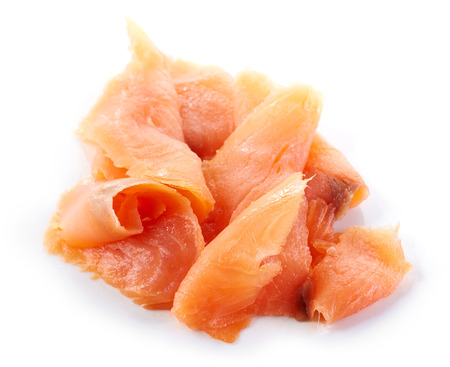 smoked salmon slices isolated on white background Фото со стока